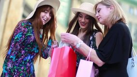 Three friends or mum with daughters go shopping.  stock video footage
