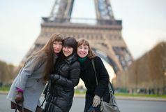 Three friends near the Eiffel tower Royalty Free Stock Photos