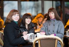 Friends in a Parisian street cafe Royalty Free Stock Photo