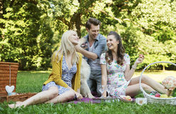 Three friends during the picnic Stock Photo