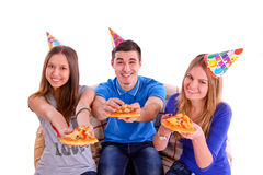 Three friends with pizza and hats isolated Royalty Free Stock Image