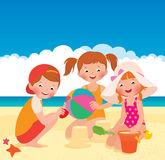Three friends playing on the beach Royalty Free Stock Images