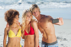 Three friends posing for a photo Royalty Free Stock Photo