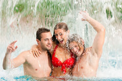 Three friends in public swimming pool Stock Photo