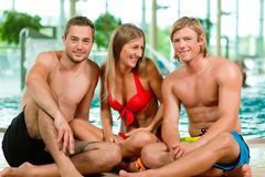 Three friends in public swimming pool Stock Photography