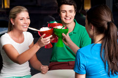 Three friends raises ice cream cup Stock Photography
