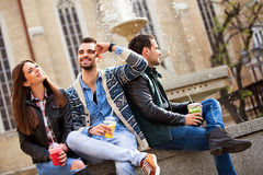 Three friends relaxing in the city with smoothies Stock Photo