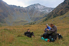 Three friends resting after descending of the mountain Royalty Free Stock Photo
