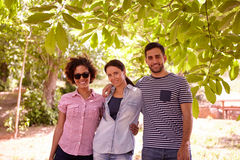 Three friends in the shade of a tree Stock Images