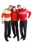 Three friends stand having embraced Stock Photos