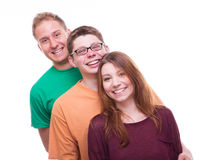 Three friends standing one after the other and laughing Stock Image