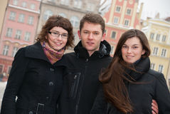 Three friends on a street Stock Photo