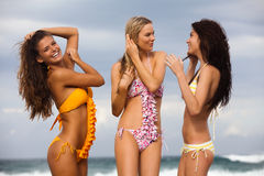Three Friends in Swimsuits at the Beach Royalty Free Stock Images
