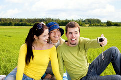 Three friends taking a photo of themselves. At picnic stock photo