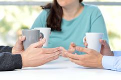 Three friends talking with coffee cups royalty free stock photos