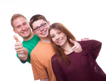 Three friends with tumbs up and smile Stock Images
