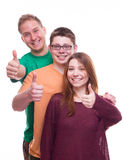 Three friends with tumbs up and smile Stock Image
