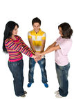 Three friends united. Three happy friends showing unity and put their hands together,check also Teenage and friends Stock Image