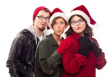 Three Friends Wearing Warm Holiday Attire Stock Images
