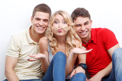 Three friends wiggling on isolated background Royalty Free Stock Photos