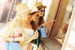 Three friends window shopping Royalty Free Stock Photo