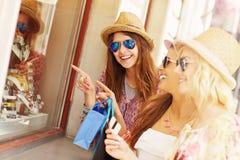 Three friends window shopping Stock Photography