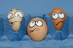 Three frightened egg face  waiting cooking Stock Image