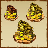 Three frog figurines sitting on gold Royalty Free Stock Images