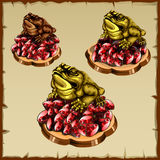 Three frog figurines sitting on ruby Royalty Free Stock Photos