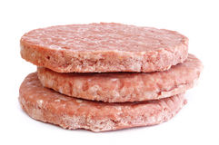 Three Frozen Hamburger Patties Stock Image