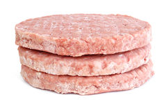 Three Frozen Hamburger Patties Royalty Free Stock Photo