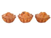 Three fruit cakes on a white background. Three fruit cakes with a raisin on a white background Royalty Free Stock Photos