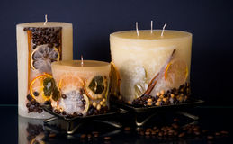 Three fruit candles on blue Royalty Free Stock Images