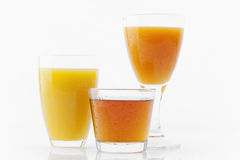 Three fruit juices Royalty Free Stock Images