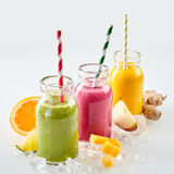 Three of fruit smoothies on ice Stock Photography