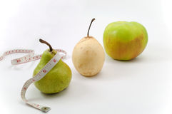 Three fruit and tape measure Royalty Free Stock Images
