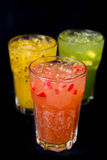 Three fruits juice in black background. Mix fruit juice in black background,Strawberry front Stock Image