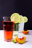 Three fruits soft-drinks with lemon on a edge of a glass. Lime a Stock Image