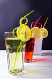 Three fruits soft-drinks with tubules lemon on a edge of a glass. Lime a Royalty Free Stock Photography