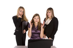 Three frustrated women with computer Royalty Free Stock Photos