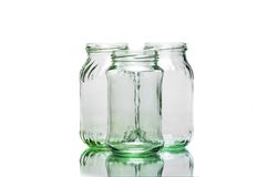 Three full jars. With green bottom and placed on white background stock images