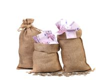 Three full sacks of euro bills. Stock Photos