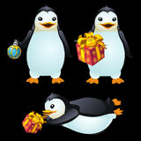 Three fun penguins with Christmas ball and gifts. Three fun vector penguins with Christmas ball and gifts Royalty Free Stock Photography