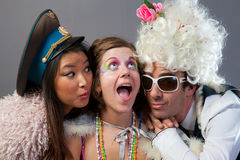 Three fun people. A group of friends ready to go out for a fun night on the town Stock Images