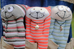 Three funny cats. Three funny knitted cats made by hands for children stock image