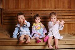 Three funny children in sauna Royalty Free Stock Image