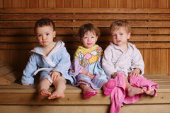 Three funny children in sauna Royalty Free Stock Photography