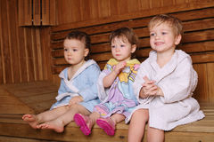 Three funny children in sauna Stock Photography