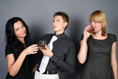 Three funny friends drinking whiskey Royalty Free Stock Photography