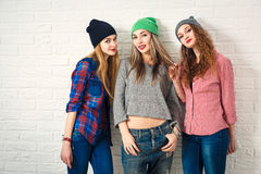 Three Funny Hipster Girls. Toned Photo. Royalty Free Stock Photo
